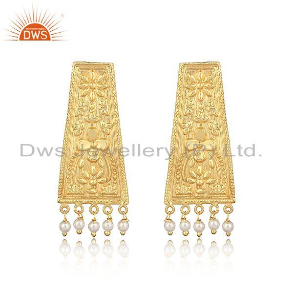 Designer textured yellow gold on fashion earring with dangle pearl