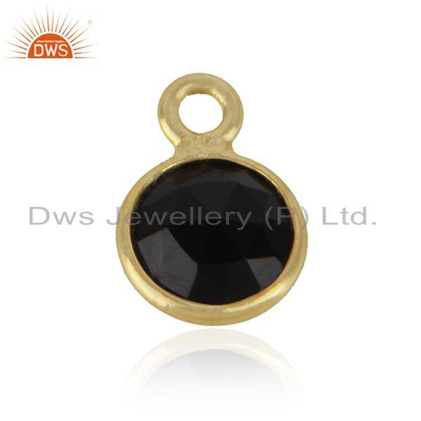 Jewelry charm made of yellow gold on silver 925 and black onyx