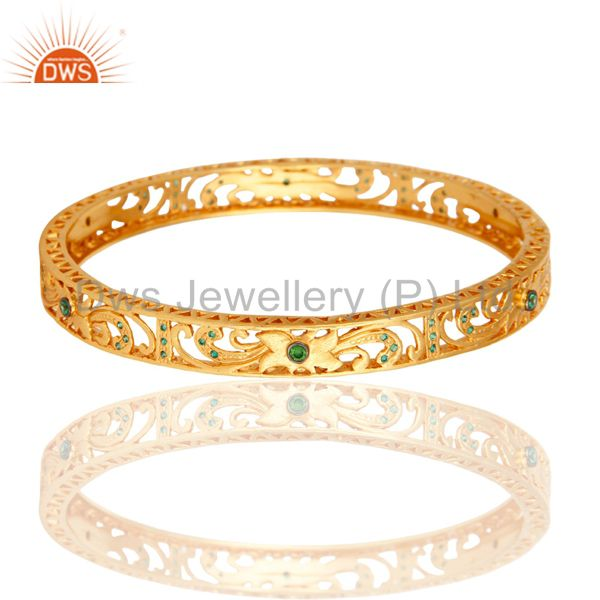 14k yellow gold plated filigree bangle with green cubic zirconia