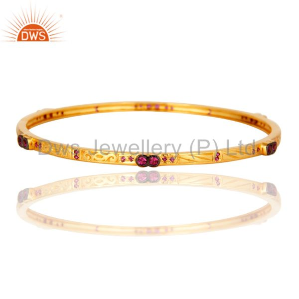 Red cubic zirconia 14k yellow gold on sleek ladies fashion bangle