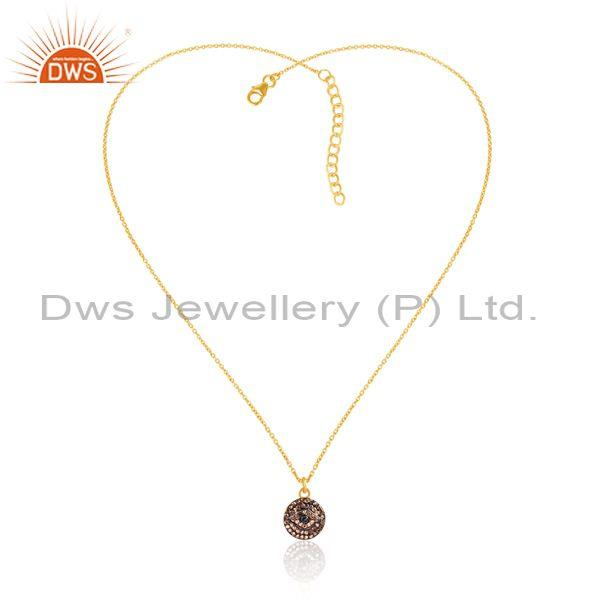 Round diamond set gold and black on silver pendant and chain