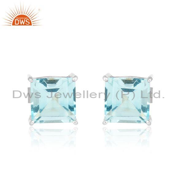 Handcrafted dainty sterling silver studs with blue topaz