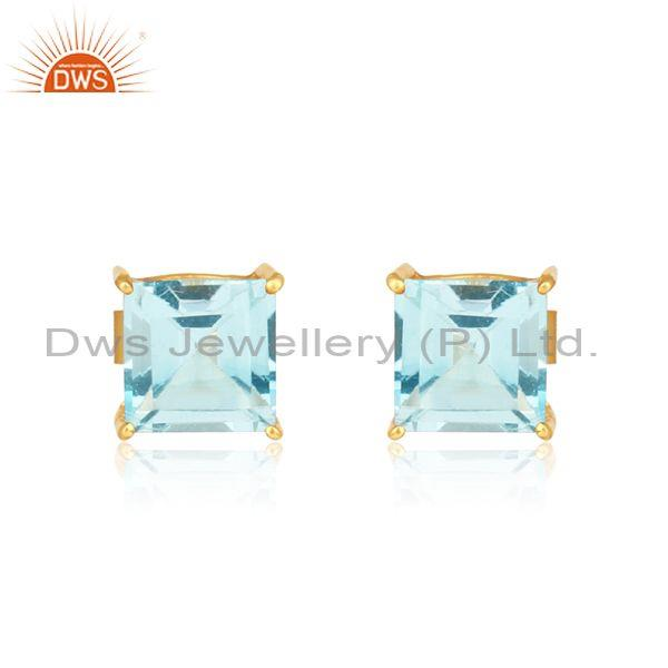 Handcrafted dainty gold on silver studs with blue topaz