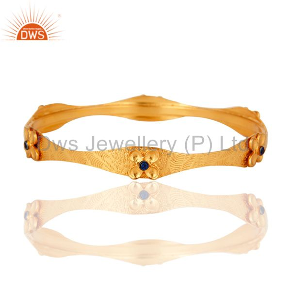 22-Carat Yellow Gold Plated Textured Design Bangle With Blue Cubic Zirconia