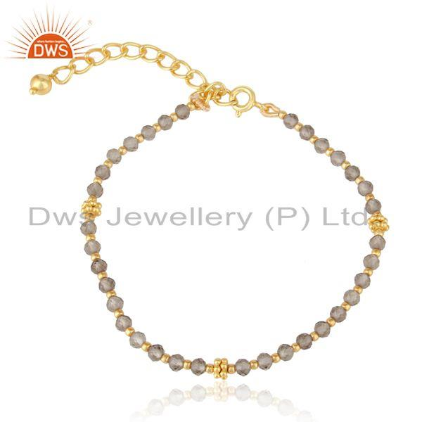 Designer smoky bead bracelet in yellow gold on silver
