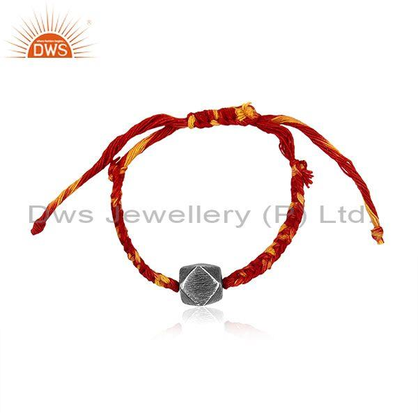 Square Oxidized Silver Charm Set Red And Yellow Cotton Dori Bracelet
