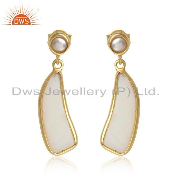 Handcrafted organic shape dangle in yellow gold on silver with pearl