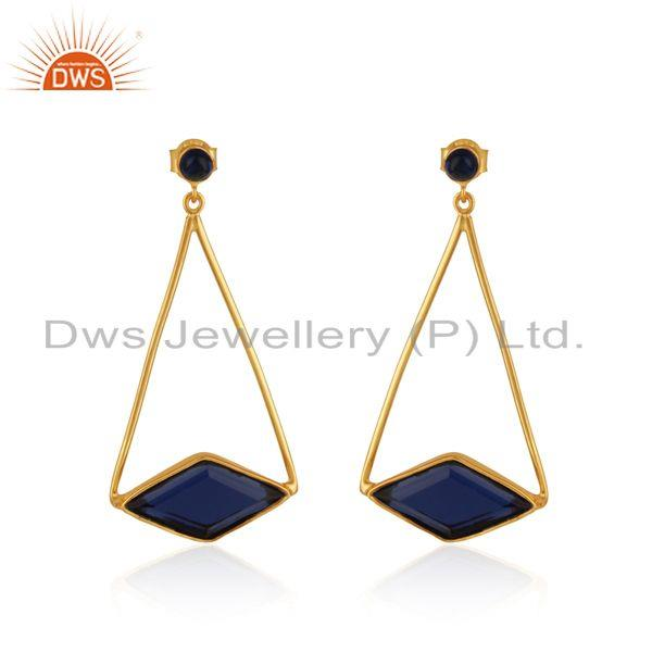 Long dangle earring in yellow gold on silver with blue corundum