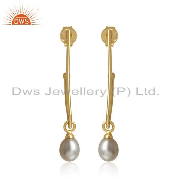Handcrafted designer dangle in yellow gold on silver with pearl