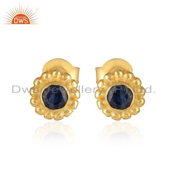 Handmade earring in yellow gold on silver with blue sapphire