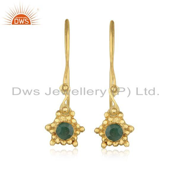 Designer dangle earring in yellow gold on silver with emerald