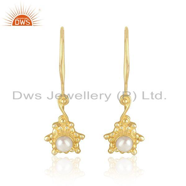 Handcrafted dangle earring in yellow gold on silver with pearl