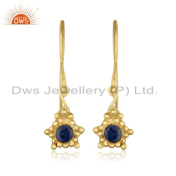 Handmade earring in yellow gold over silver and blue sapphire