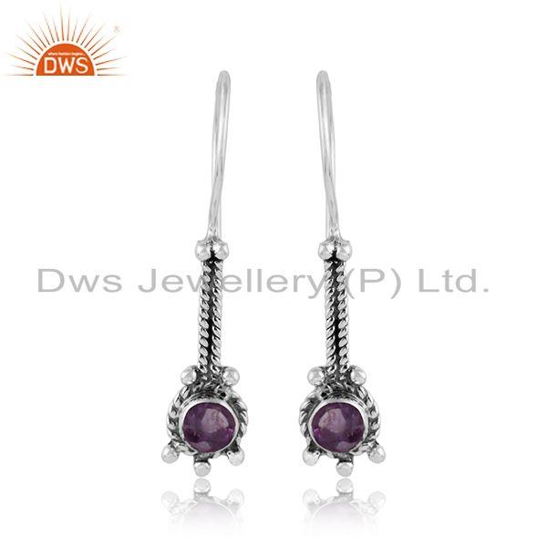 Elongated designer earring in oxidized silver with natural amethyst