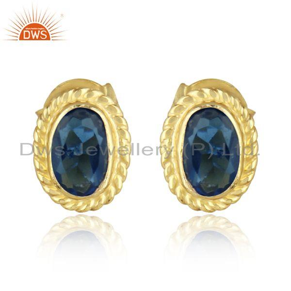 Textured silver stud with blue corundum and yellow gold plating
