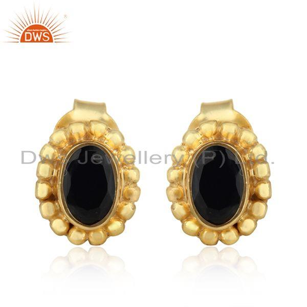 Textured dainty stud in yellow gold over silver with black onyx