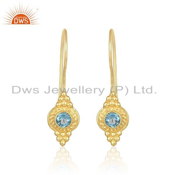 Textured earring in yellow gold on silver 925 with blue topaz