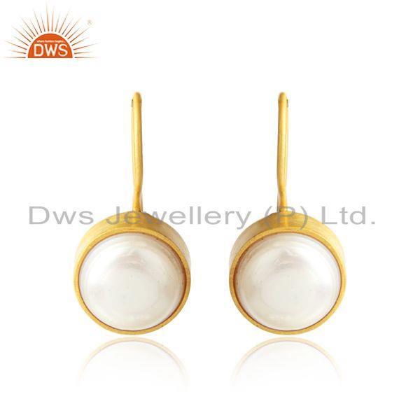 Handmade earring in yellow gold on silver crafted with pearl