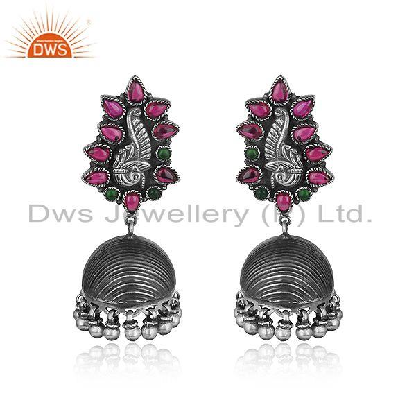 Handcrafted textured tribe jhumka in oxidized silver and red stones
