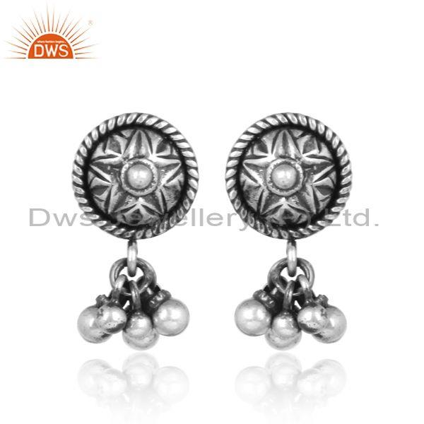 Handmade carved oxidized silver star shaped ethnic earrings
