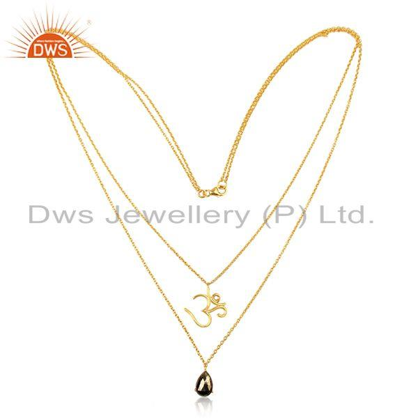 Double layerd om necklace in yellow gold on silver 925 and pyrite