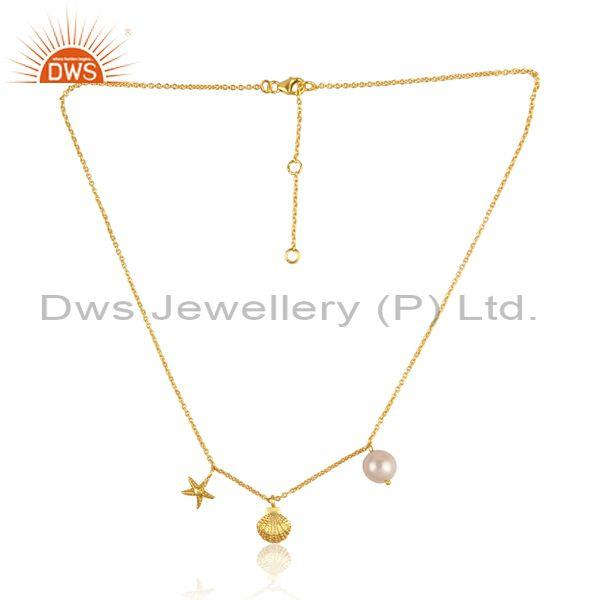 Pearl, star, and round charms set gold on silver necklace