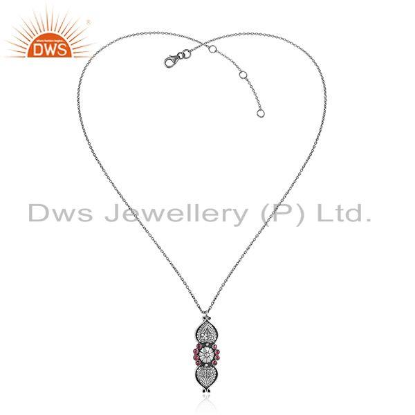 Handcrafted tribal design necklace in oxidized silver and red stone