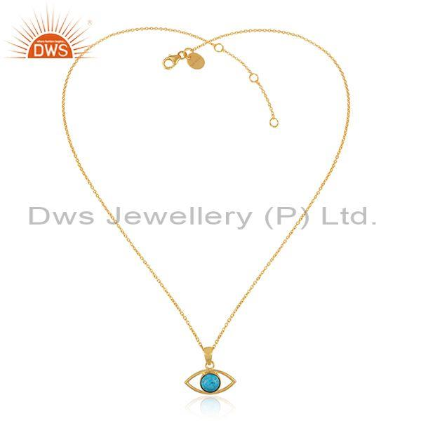 Turquoise set gold on sterling silver eye pendant and chain