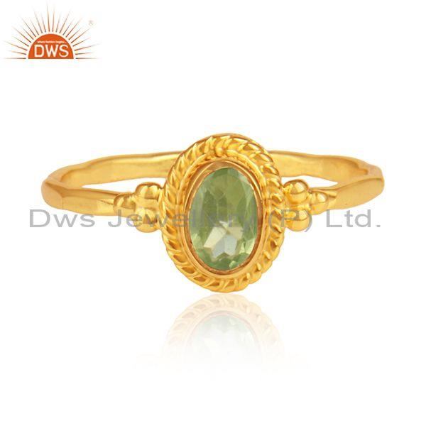 Oval peridot set gold on silver hand hammered ethnic ring