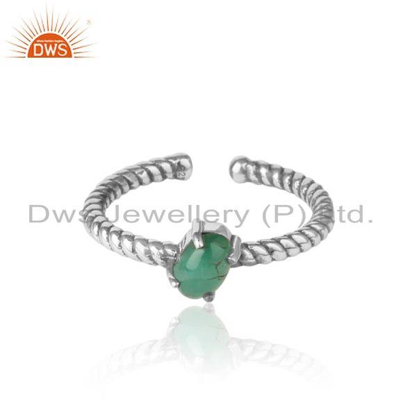 Dainty oxidized silver ring adorn with tilted natural emerald
