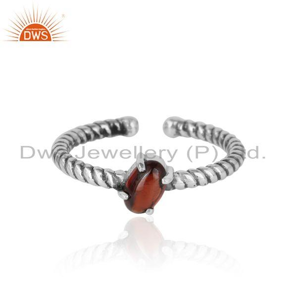 Dainty oxidized silver ring adorn with tilted natural garnet