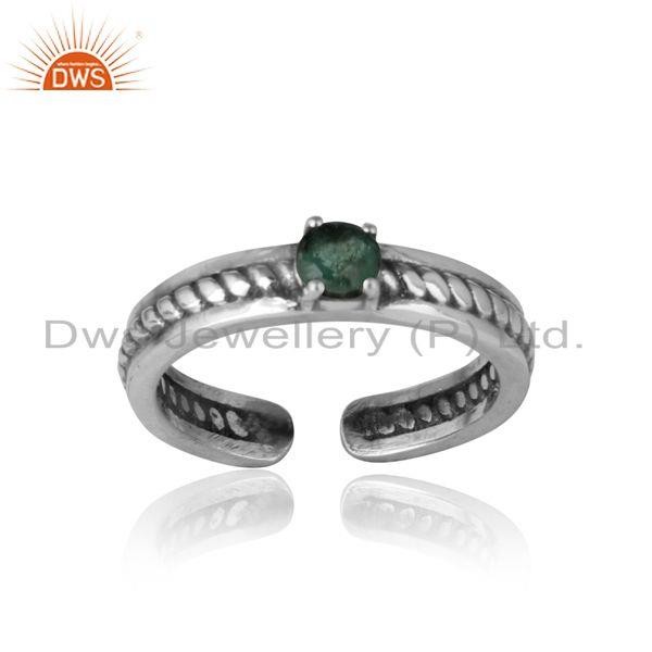 Designer twisted ring in oxidized silver 925 and emerald