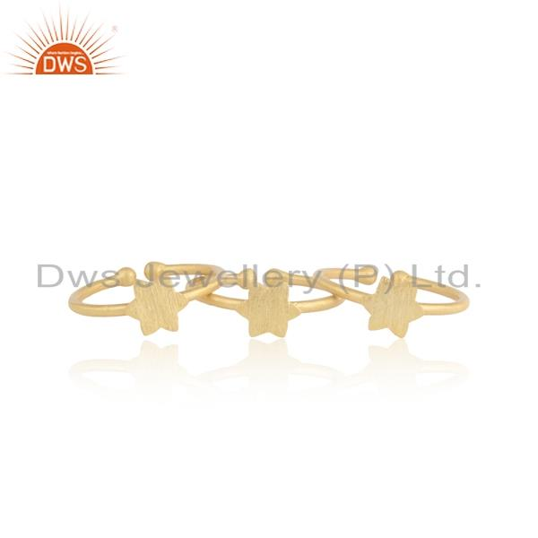 Textured dainty multi star 3 rings set in yellow gold on silver