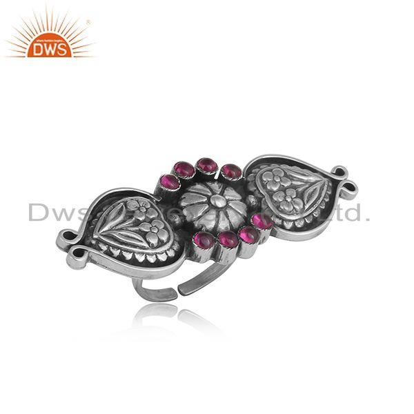Handcrafted tribal design ring in oxidized silver and red stone