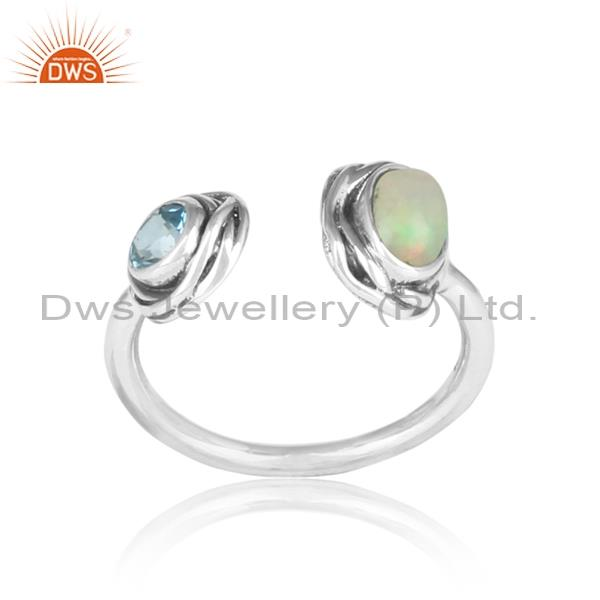 Ethiopian opal cabushion and blue topaz silver facing ring