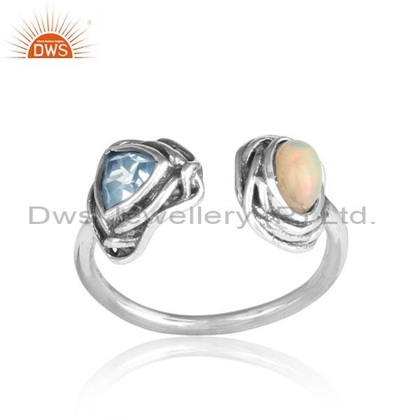 Ethiopian opal cabushion and blue topaz cut silver ring