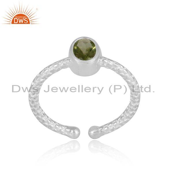 Round peridot set hand hammered fine sterling silver ring