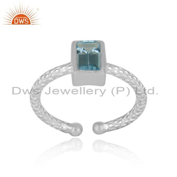 Rectangular blue topaz set fine silver hand hammered ring