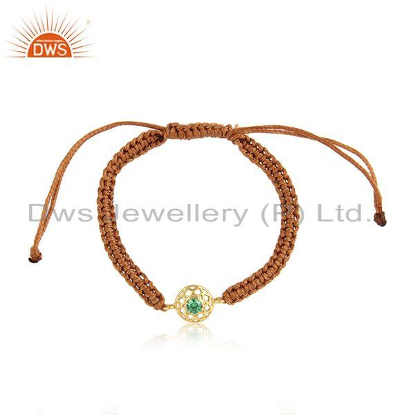 Floral designer brown cord bracelet in gold on silver and green cz