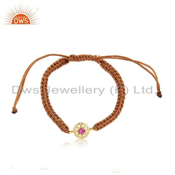 Floral designer brown cord bracelet in gold on silver and red cz