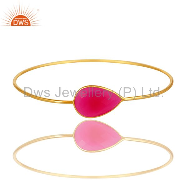 Dyed pink chalcedony over brass bangle with 18k yellow gold plated