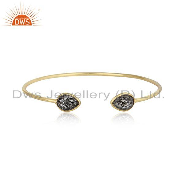 Handmade sleek cuff in yellow gold on silver 925 with black rutile