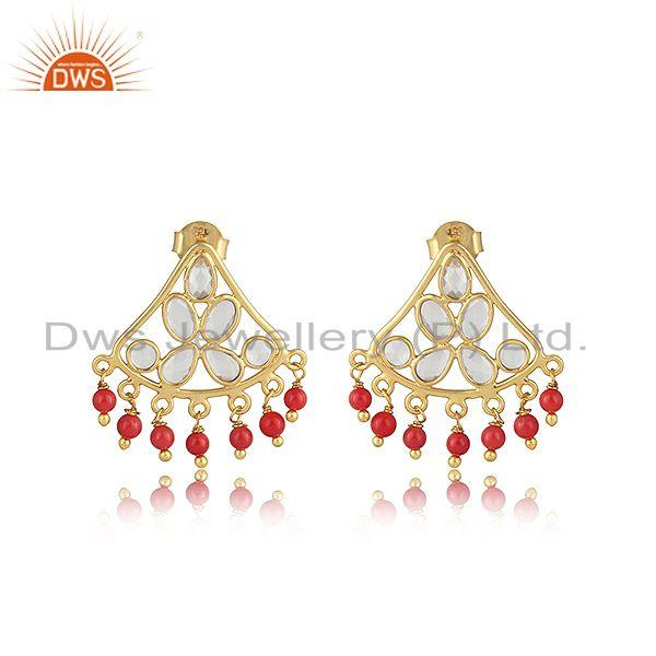 Traditional designer earring in gold on silver with coral and cz