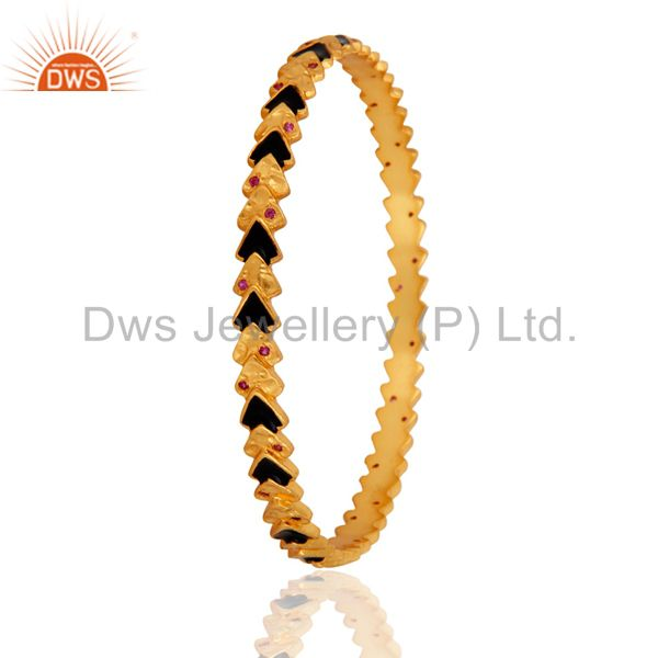 Supplier of 14k yellow gold over red cubic zirconia fashion bangle black enamel