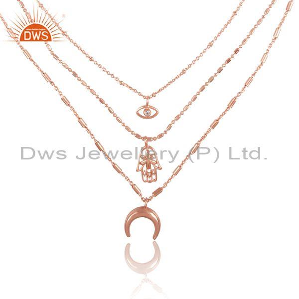Cz and charms set rose gold on brass triple chain necklace
