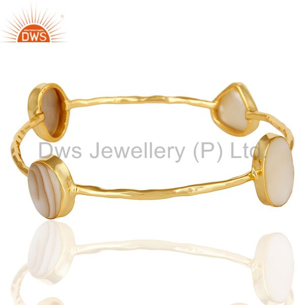 Supplier of 14k yellow gold over sterling silver mother of pearl sleek bangle