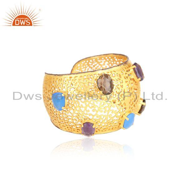 Bold filigree cuff in yellow gold on silver with multi gemstones