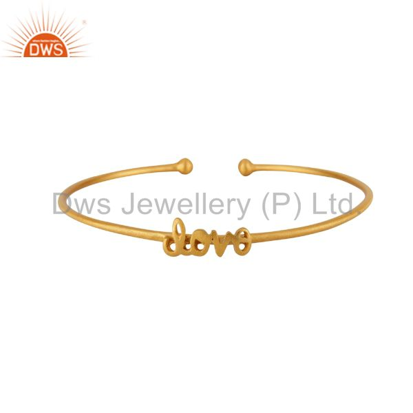 Supplier of 22k yellow gold on sterling silver matte finish love torque bangle