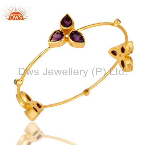 Supplier of 14k shiny yellow gold plated brass sleek bangle amethyst and cz