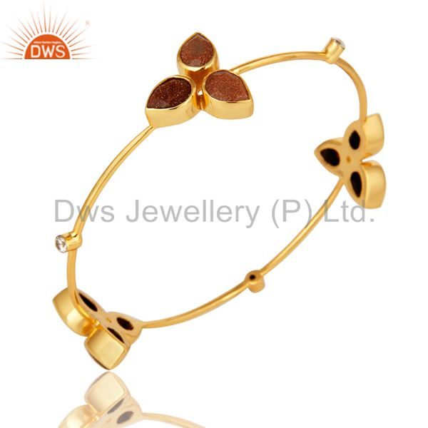Supplier of 18k yellow gold plated red sun sitara and cz stackable bangle
